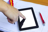 Tablet computer over engineering diagram — Stock Photo
