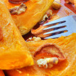 Baked pumpkin with dried fruits and nuts — Stock Photo #39058373