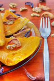 Baked pumpkin with dried fruits and nuts — Stock Photo