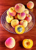 Apricots on wooden table — Stock Photo