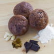 Chocolate muffins with ingredients — Stock Photo