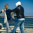Woman defending herself against assailant — Stock Photo