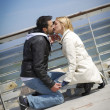 Young loving couple at wharf — Stock Photo