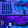Dj mixes the track in the nightclub at party — Foto Stock