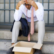 Man with charity box losing his job — Stock Photo