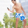 Businessman surf with smart phone outside office — Stock Photo