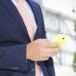 Businessman holding smart phone — Stock Photo