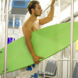 Young surfer travel in metro — Stock Photo