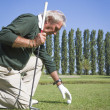 Senior man playing golf — Stock Photo