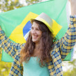 Woman with flag of Brazil — Stock Photo