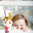 Stock Photo: Gluttonous womwants cup of ice cream