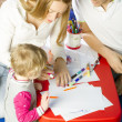 Family drawing together — Stock Photo #42529667
