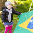 Little Brazilian supporter with flag — Stock Photo