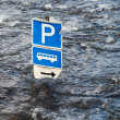 Flood river and bus parking — Stock Photo