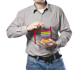 Man with abacus in the hands — Stock Photo
