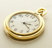 Golden pocket watch — Stock Photo