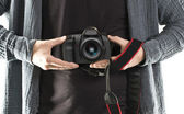 DSLR camera holding in a hand — Stock Photo