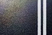 Asphalt detail with white double line — Stock Photo