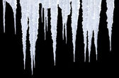 Icicles on black with photoshop path — Stock Photo