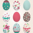Stock Vector: Set of color painted Easter eggs,flower pattern vector background