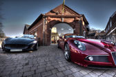 2 Sport cars parked parked outside a building — Stock Photo