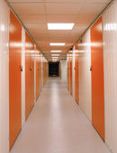 Self Storage Corridor with Red Doors — Stock Photo