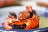 Crayfish on a plate with selective blur — Stok fotoğraf