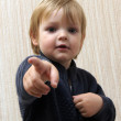 Child shows her finger — Stock Photo
