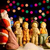 Choir singing christmas carols — Stock Photo