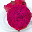 Red dragon fruit cut to half - Stockfoto