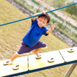 Stock Photo: Boy climbing with determination