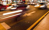 Busy traffic in the city at night — Stock Photo