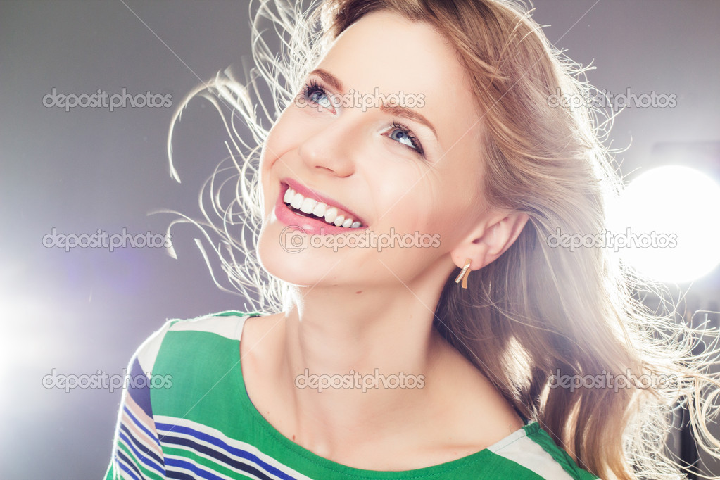 Stock photo beautiful blonde girl laughing