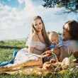 Young happy family on a rest — Stock Photo