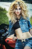 Sexy stylish woman on a motorcycle — Stock Photo