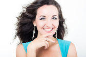 Beautiful young woman laughing with her hand near face — Stock Photo
