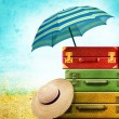 Suitcases with Summer Hat on the vintage background — Stock Photo #23512151