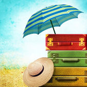 Suitcases with Summer Hat on the vintage background — Stock Photo