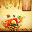 Vegetables in a basket on the kitchen table - Stock Photo