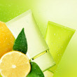 Tubs lemon cream. Natural cosmetic background. — Stock Photo #25092127
