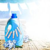 Liquid laundry detergent on the sunny sky background — Stock Photo