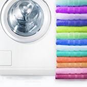 Pile of towels and washing machine — Stock Photo