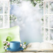 Cup of tea and book on window sill in a home — Stock Photo