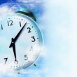Clock in the blue sky — Stock Photo