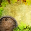 Wine barrel and grape on the old wall background — Stock Photo