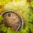 Wine barrel and grape on the old wall background - Stock Photo