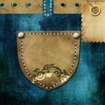 Leather pocket. Denim background — Stock Photo #25503525