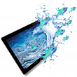 Water splash with colored fish from tablet computer. — Stock Photo