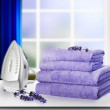 Pile of towels and smoothing-iron. — Foto Stock