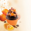 Decorated chocolate cupcake with orange colored fruit jelly. — Stock Photo